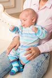 Mother holding her baby son in the room. Young mother infant baby son in the room Royalty Free Stock Image