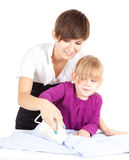 Young mother ironing with little daughter Stock Photos