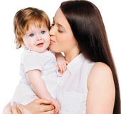 Young mother kiss little baby Stock Photo
