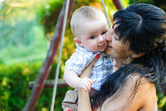 Young mother kissing her little son Royalty Free Stock Image