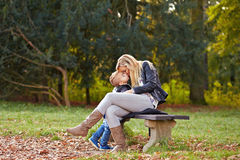 Young mother kissing her son Royalty Free Stock Images