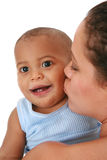 Young Mother Kissing Smiling Baby Stock Photos