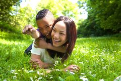 Young mother laughing with her son outdoors Stock Photos