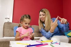 Young mother learning her daughter how to count royalty free stock photo