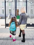 Mother brought her daughter to school, view from behind, Concept family stock images