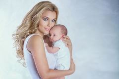 Young mother with little baby. royalty free stock photography