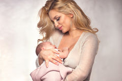 Young mother with little baby. stock images