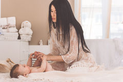 Young mother with little baby boy Stock Images