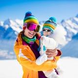 Family ski and snow fun in winter mountains Stock Image