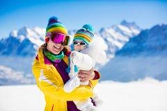 Family ski and snow fun in winter mountains Royalty Free Stock Photos