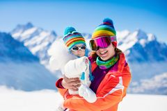 Family ski and snow fun in winter mountains Royalty Free Stock Image