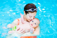 Young mother and little baby son in swimming pool Stock Images