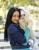A young mother with a little child at her arms Royalty Free Stock Photo