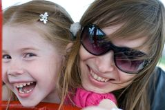 Young mother and little daughter. Happy young mother and her little daughter are laughing Stock Photography