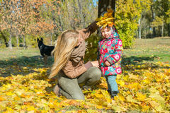 Young mother with little daughter in autumn park royalty free stock image