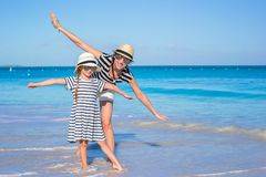 Young mother and little daughter have fun at Royalty Free Stock Image