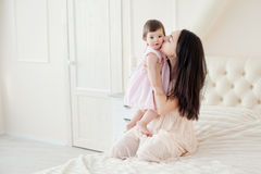 Young mother with little daughter at the houme stock photo