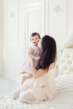 Young mother with little daughter at the houme stock photography