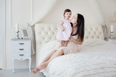 Young mother with little daughter at the houme Stock Photos