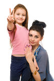 Young mother and little daughter. Isolated Royalty Free Stock Photo