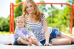 Young mother and little daughter playing at playground Royalty Free Stock Photography