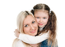 Young mother little daughter Stock Images