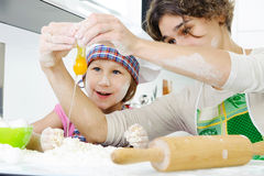 Young mother with little daughter preparing cookies Stock Photography