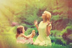 Young mother and little girl have a rest Royalty Free Stock Images