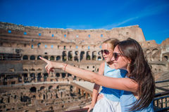 Young mother and little girl hugging in Coliseum, Rome, Italy. Family portrait at famous places in Europe Royalty Free Stock Image