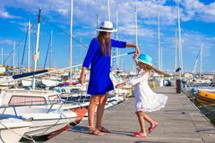 Young mother and little girl in port during summer Royalty Free Stock Photos