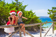 Young mother and little girl in red Santa hat at Stock Image