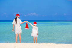 Young mother and little girl in Santa hat Stock Photo