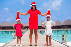 Young mother and little girls in Santa hat Stock Photo