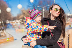 Young mother and little happy girl relax in spring park at sunny day Stock Photos