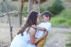 Young mother with little son. Happy family concept stock photos