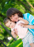 Young mother and little son in park Stock Photos