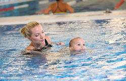 Young mother and little son in a swimming pool. Portrait of young mother and little son in a swimming pool Stock Images