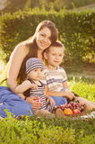 Young mother with little sons Stock Photos