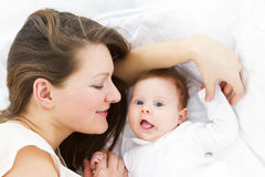 Mother with baby in bed Royalty Free Stock Photos