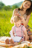 Young mother making hairstyle to her daughter Royalty Free Stock Images
