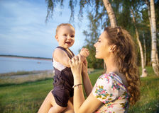 Young mother making her baby laughing Royalty Free Stock Image