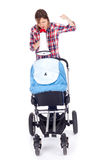 Young mother with megaphone and baby pram. Shouting young mother with megaphone and baby pram Royalty Free Stock Image