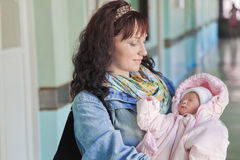 Young mother with newborn baby in hospital. At the day of discharge from maternity ward Royalty Free Stock Image