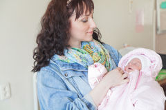 Young mother with newborn baby in hospital room Stock Photography