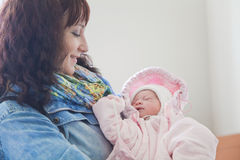 Young mother with newborn baby in hospital room Royalty Free Stock Photos
