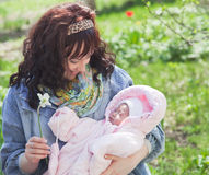 Young mother with newborn baby in outdoors at spring day Stock Images