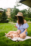 Young mother with newborn baby Stock Photos