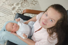 Young mother newborn her lap armchair top view Stock Photo