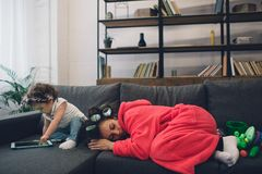 Young mother old is experiencing postnatal depression. Sad and tired woman with PPD. She does not want to play with her. Young mother old is experiencing Stock Image