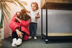 Young mother old is experiencing postnatal depression. Sad and tired woman with PPD. She does not want to play with her. Young mother old is experiencing Royalty Free Stock Photos